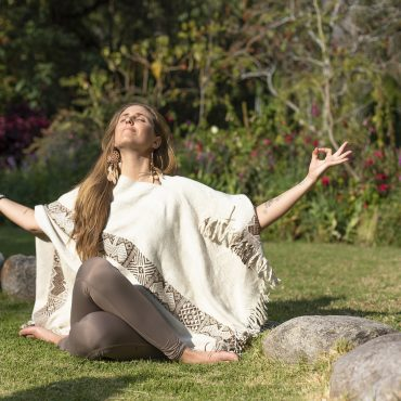 Woman practicing yoga in the garden