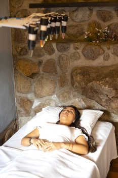 Woman laying in the bed during crystal therapy